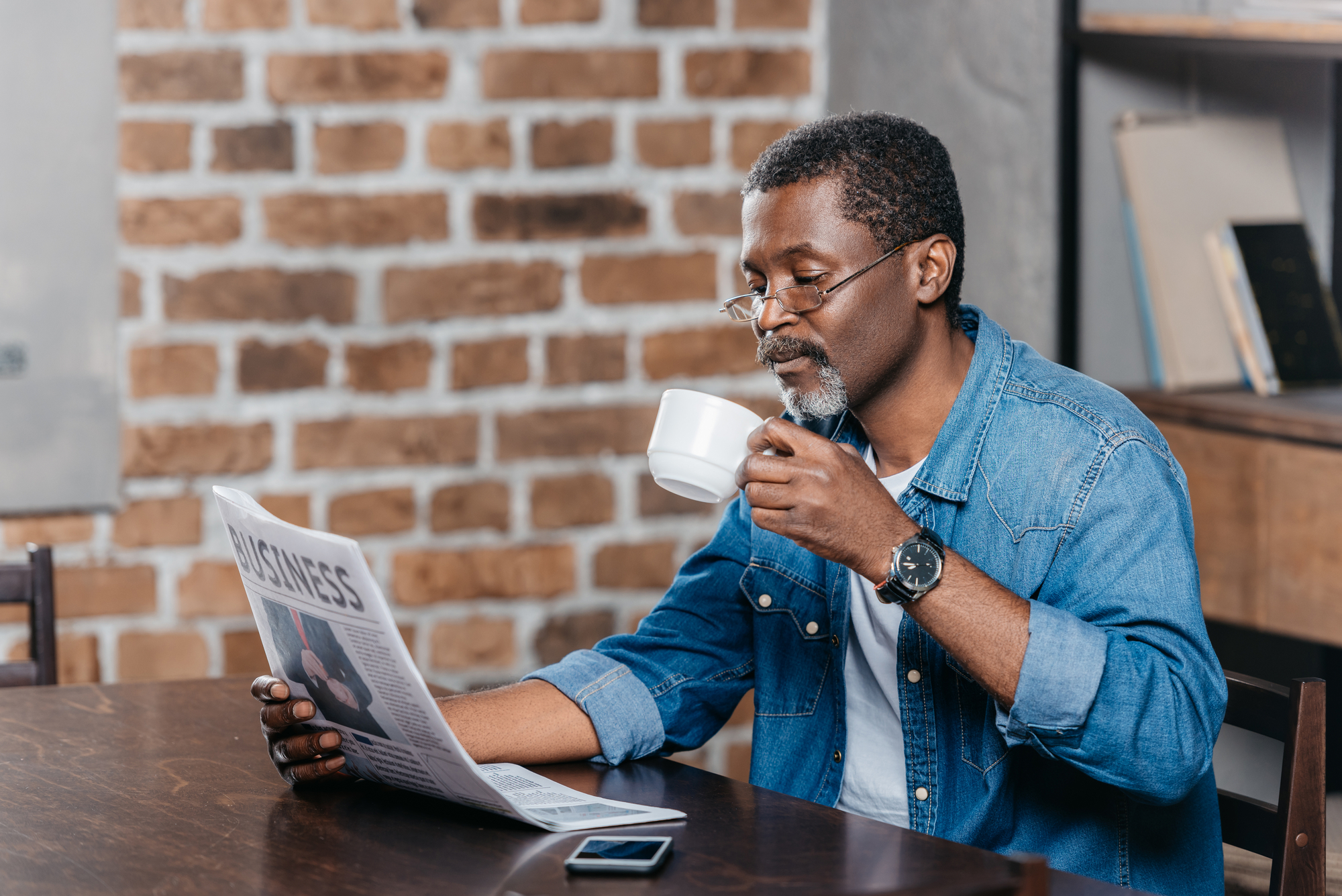 African american man reading newspaper