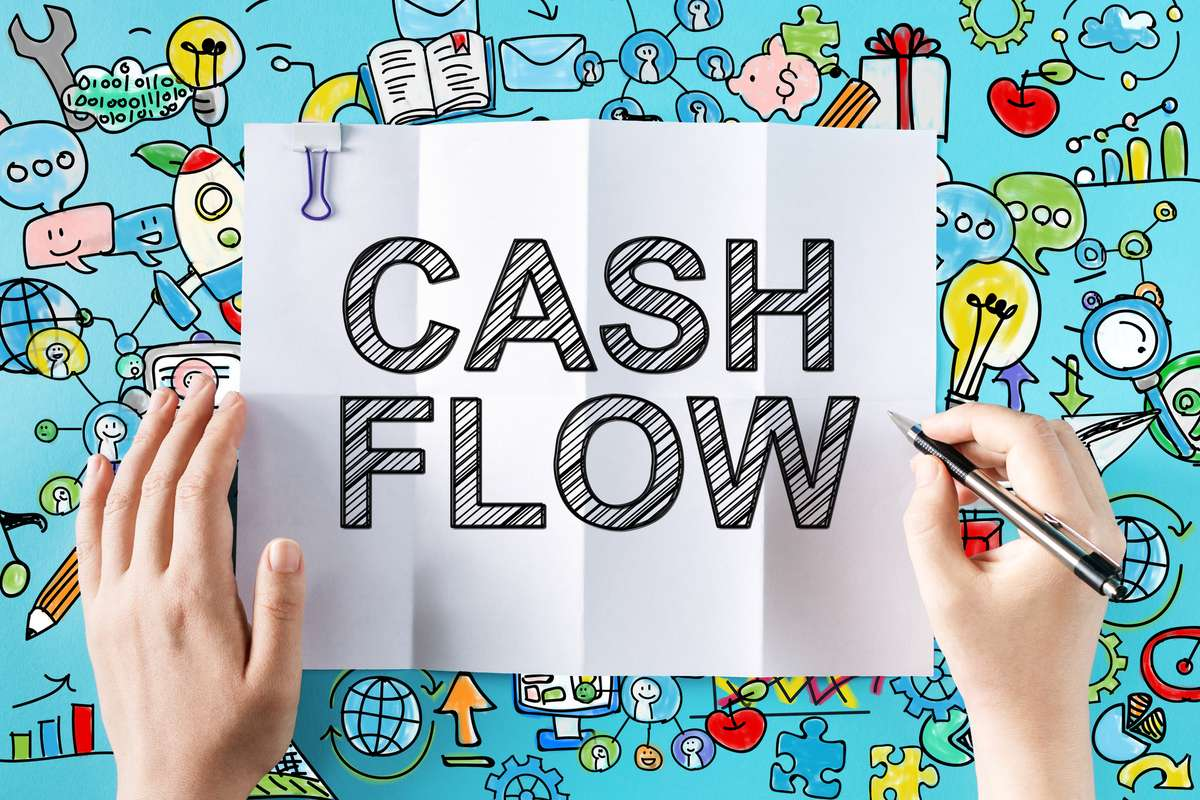 Cash Flow text with hands (R) (S)