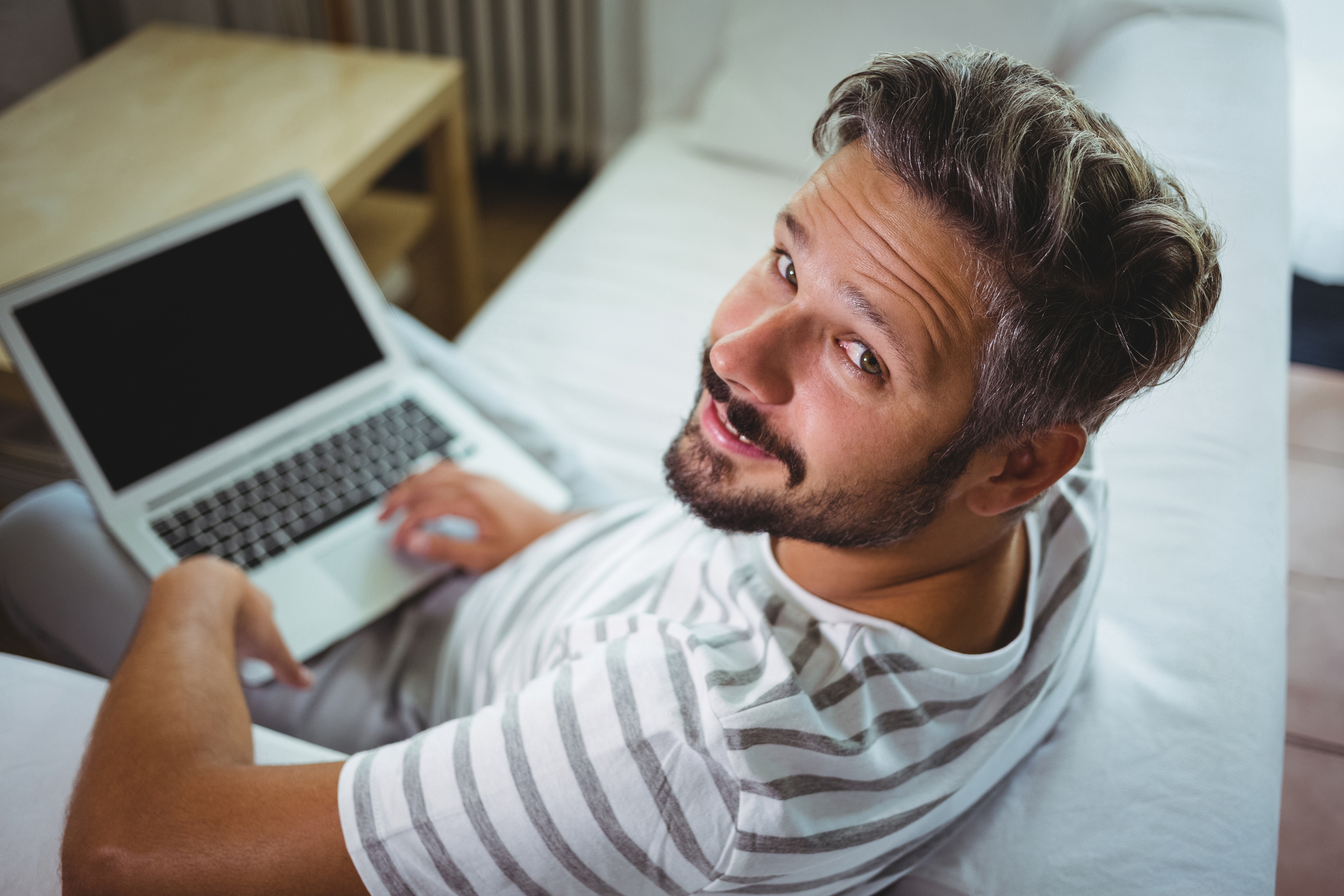 Man using his laptop in living room