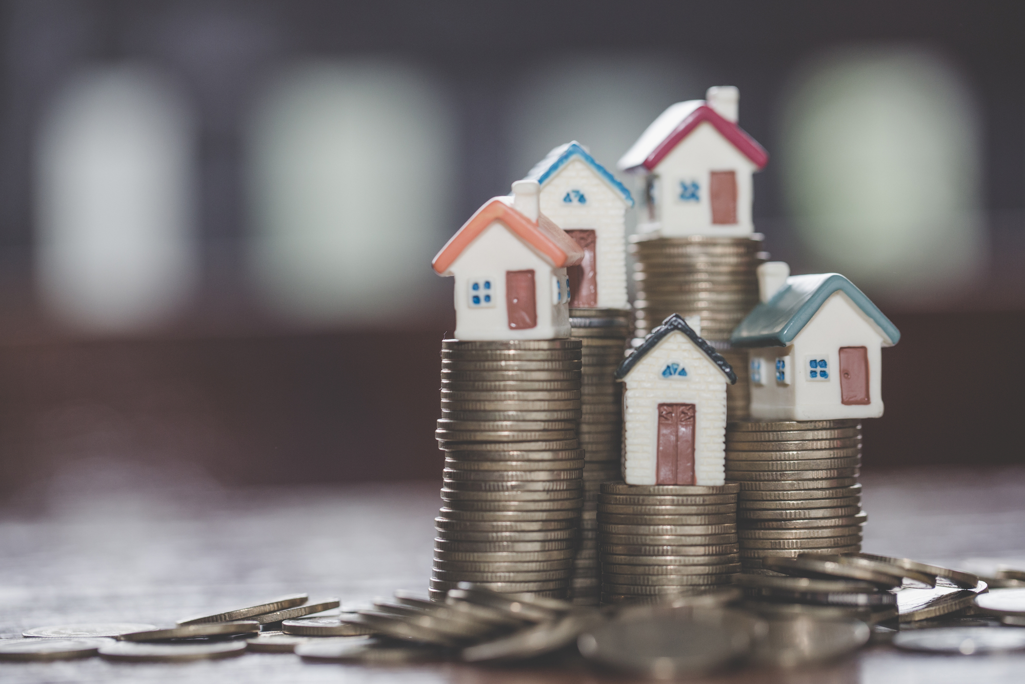 Mini house on stack of coins Mortgage Savings money for buy house and loan to business investment for real estate Invesment and Risk Management