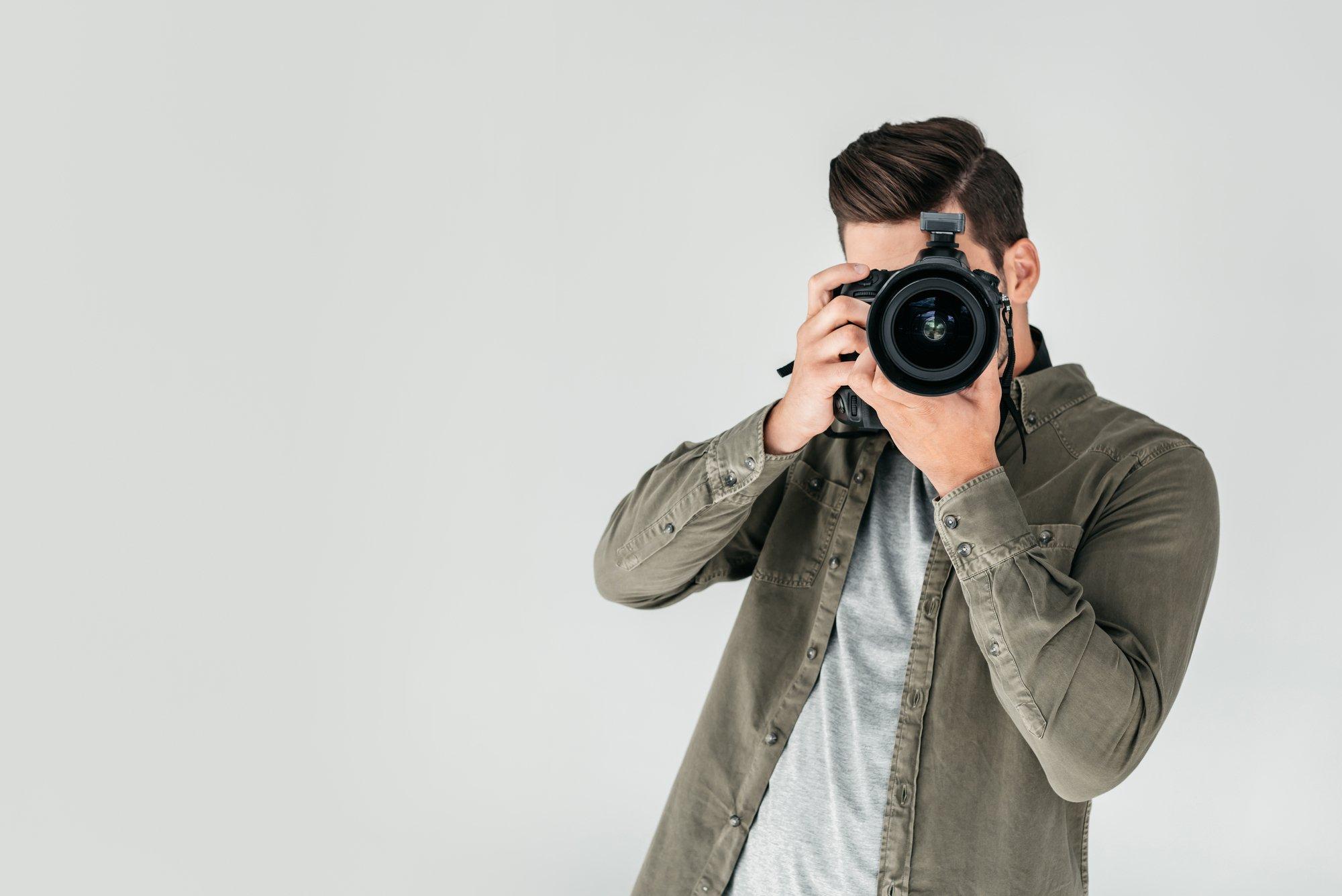 Photographer with digital photo camera
