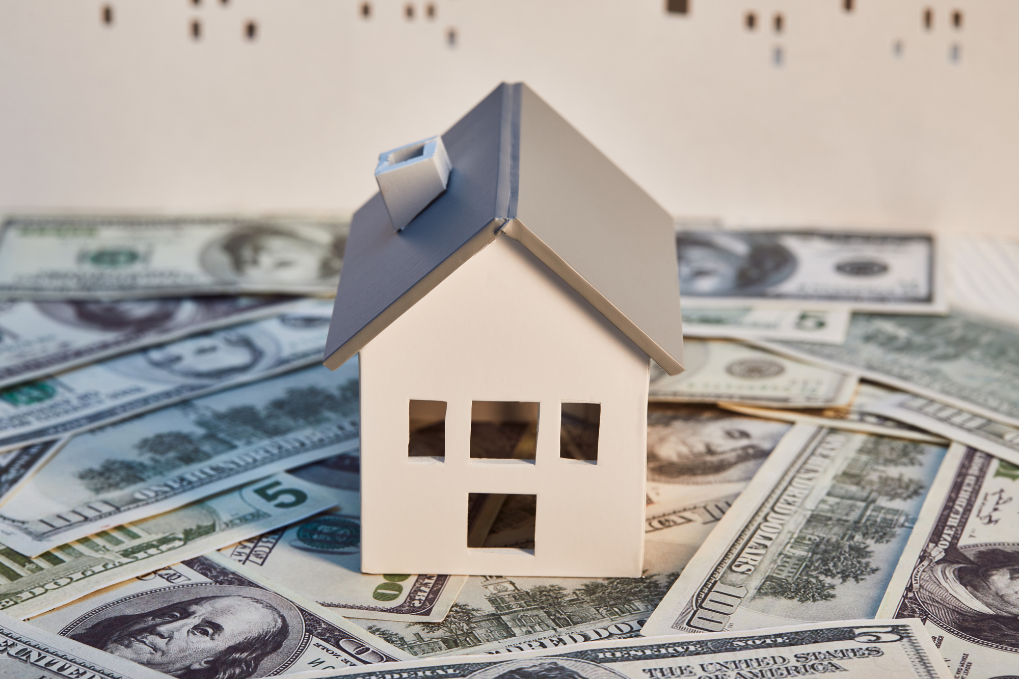 White house model on dollar banknotes, real estate concept