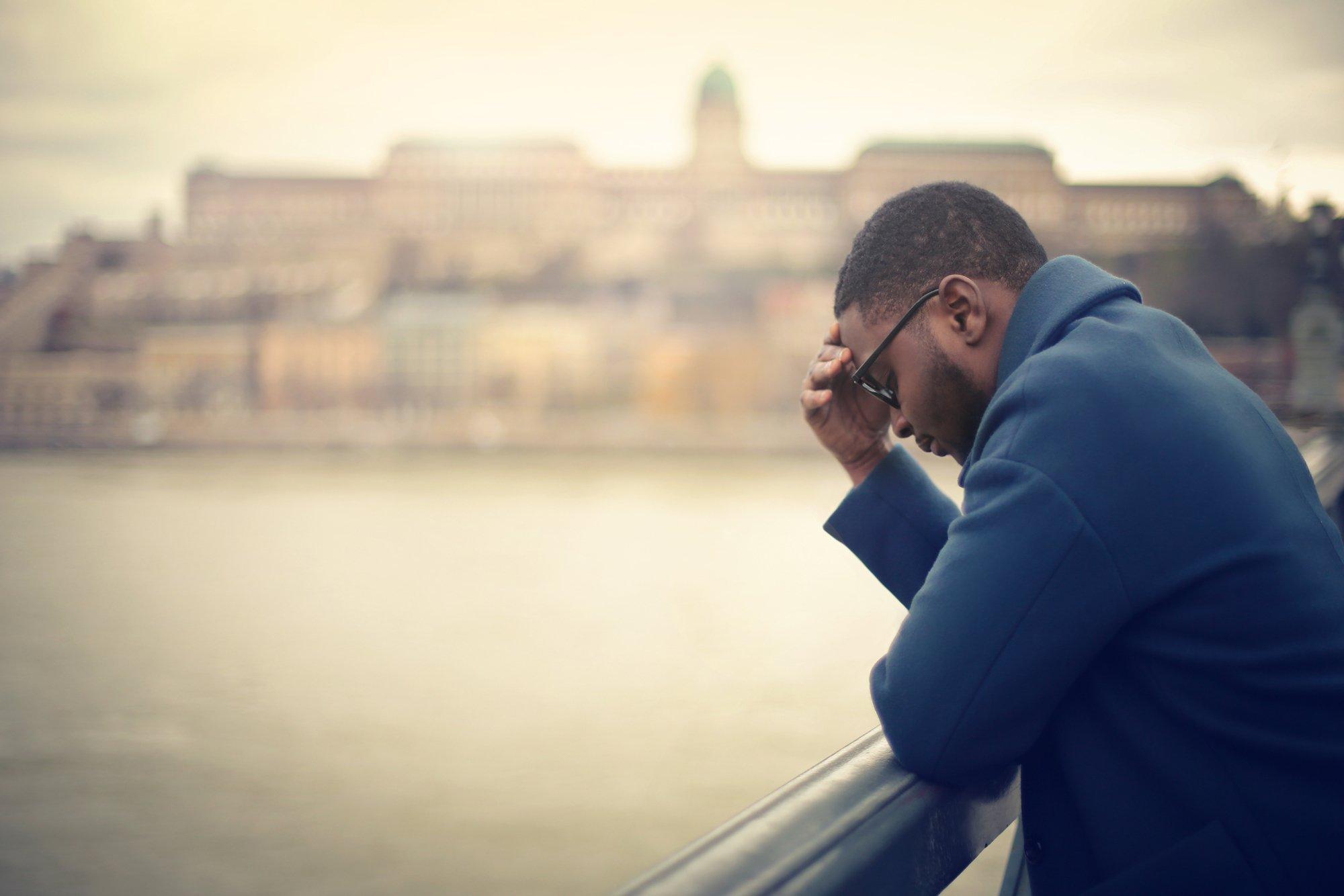Worried businessman in a bridge